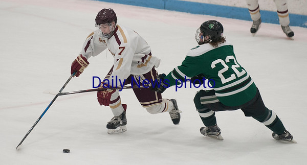 JIM VAIKNORAS/Staff photo Newburyport's Patrick Leary  controls the puck against Austin Prep at Chelmsford Forum in Billerica Saturday.