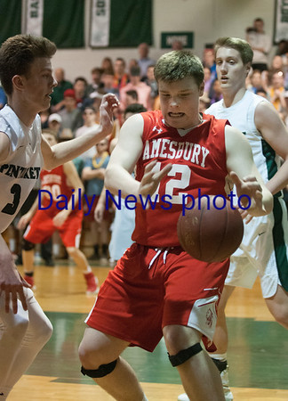JIM VAIKNORAS/Staff photo Amesbury's Thomas McAndrews grabs a loose ball against Pentucket at Pentucket Wednesday night.