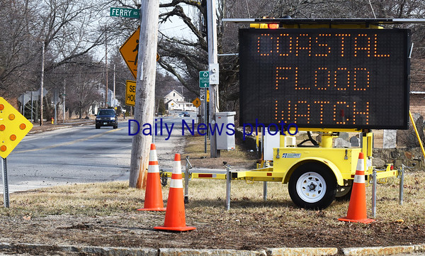 BRYAN EATON/Staff photo. Mass. DOT has a sign on Beach Road at Ferry Road in Salisbury warning about today's storm and to plan ahead.