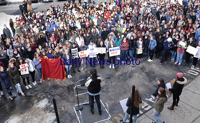 BRYAN EATON/Staff photo. Newburyport High School students gather behind the school to listen to a handful of speakers after walkout out the  front entrance.