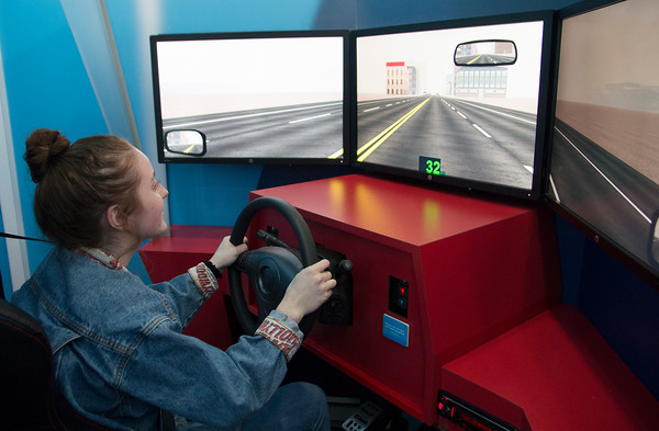 JIM VAIKNORAS/Staff photo Newburyport high junior Liz Dodson takes a drive in a distracted driving simulator at the school Friday.