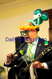 JIM VAIKNORAS/Staff photo State Representative Jim Kelcourse performs during Irish Idol at the Link House, Inc. St. Patrick's Day luncheon and fundraiser Friday morning at the Masons in Newburyport.