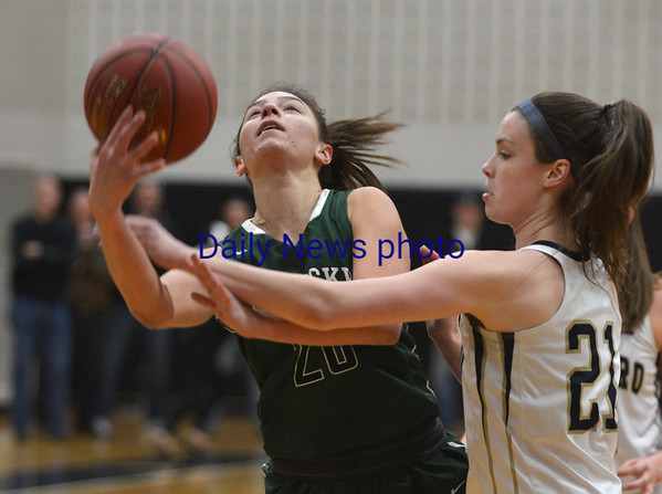 JIM VAIKNORAS/Staff photo Pentucket's Casey Hunt is fouled against Foxboro at Woburn high Wednesday night.