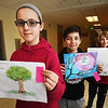 "BRYAN EATON/Staff photo. Molin Upper Elementary School students show their winning artwork in a contest called ""My Community, My Trees"" by the Mass. Department of Conservation and Recreation (DCR). From left, winner, Laney Schwab, 11, and runners up Mark Mosesian, 11, and Christian Field, 10."