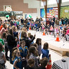 JIM VAIKNORAS/Staff photo The gym at the Pine Grove School in Rowley was filled Saturday morning with girls racing pinewood cars. for the Over 50 Rowley Girl Scouts competed their first Pinewood Derby.