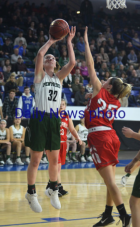 JIM VAIKNORAS/Staff photo Pentucket's Olivia Cross scores against Wakefield Saturday at the Tsongas Center in Lowell. The win gave the Sachems the North Sectional Championship.