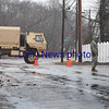 BRYAN EATON/Staff photo. The Army National Guard helped out in Salisbury, here blocking traffic to the beach as the area near the entrance to the Salisbury Beach State Reservation wouldn't drain around 3:00 on Friday. One had to go to the beach via Route 286 in Seabrook at the time.