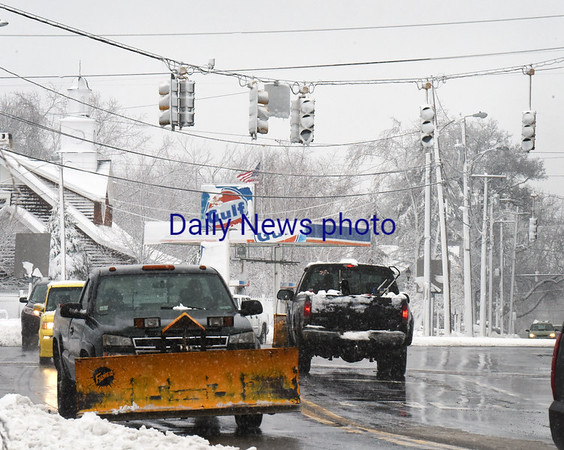 BRYAN EATON/Staff photo. Motorists had to take turns and work together without traffic signals, here in Salisbury Square.