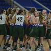 JIM VAIKNORAS/Staff photo Pentucket's girls basketball team celebrate after their victory over Wakefield Saturday at the Tsongas Center in Lowell. The win gave the Sachems the North Sectional Championship.