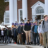 BRYAN EATON/Staff photo. Students file out of Newburyport High School during a walkout at 10:00 a.m. on Thursday morning.