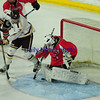 JIM VAIKNORAS/Staff photo  Newburyport's Owen Bradbury shot is saved by Winchester's Robert DiVincendo at the Tsongas Center in Lowell Thursday night.