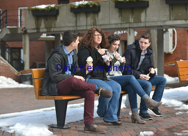 JIM VAIKNOARAS/Staff photo Elijah, Mary Ellen, Annabelle, and Liam Siegler of Newbury enjoy ice cream on Inn Street in Newburyport. Despite there being snow on the ground, they just couldn't wait till spring.