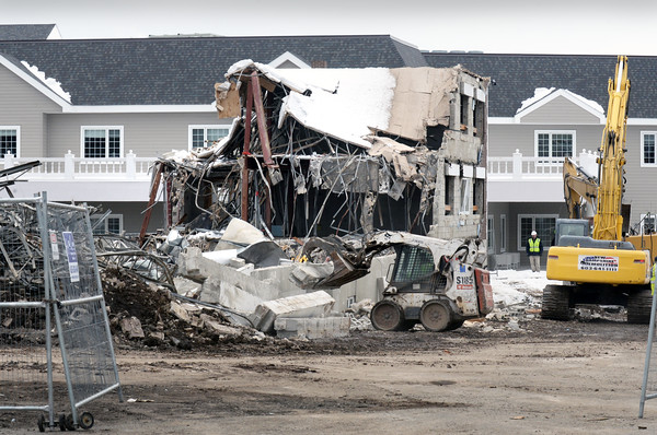 BRYAN EATON/Staff photo. The demolition of the the old Port Healthcare Center on Hale Street in Newburyport is almost complete in front of the new facility which opened at the end of last year. The space will become parking for employees and visitors to the residents there.