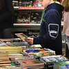 BRYAN EATON/Staff photo. Keegan Koch, 11, checks out the offerings at the book fair at the Pine Grove School looking for books on sports or fiction titles. The event is sponsored by the Student Activities Club and raises money for the school's library.