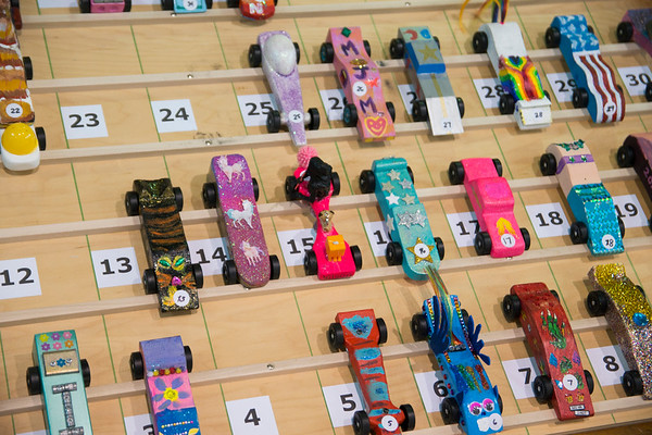 JIM VAIKNORAS/Staff photo A wide variety of designs wait for their heats at the Pine Grove School Saturday. Over 50 Rowley Girl Scouts competed their first Pinewood Derby.