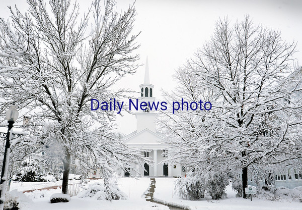BRYAN EATON/Staff photo. A winter wonderland in front of the Main Street Congregational Church in Amesbury.
