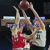 JIM VAIKNORAS/Staff photo Pentucket's Emily Riley grabs a rebound against Wakefield  Saturday at the Tsongas Center in Lowell. The win gave the Sachems the North Sectional Championship.