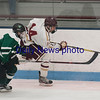 JIM VAIKNORAS/Staff photo Newburyport's Declan Sullivan clears the puck against Austin Prep at Chelmsford Forum in Billerica Saturday.