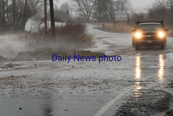 BRYAN EATON/Staff photo. Water flows over the Plum Island Turnpike just east of Ocean Avenue in Newburyport.