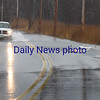 BRYAN EATON/Staff photo. A section of Ferry Road in Salisbury was covered with water overflowing from the marsh.