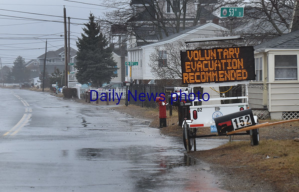 "BRYAN EATON/Staff photo. Though signs suggested evacuating Plum Island, it seems most people just ""hunkered down."""