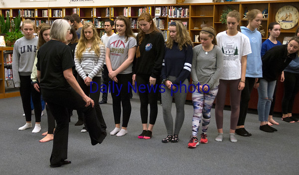 JIM VAIKNORAS/Staff photo A group of Newburyport high school students who are planning a trip to China take a lesson in Tai Chi from Barbara Tilden at the school library Wednesday night.