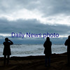JIM VAIKNORAS/Staff photo People take photos early Sunday morning of the high surf at Salisbury Beach Center.
