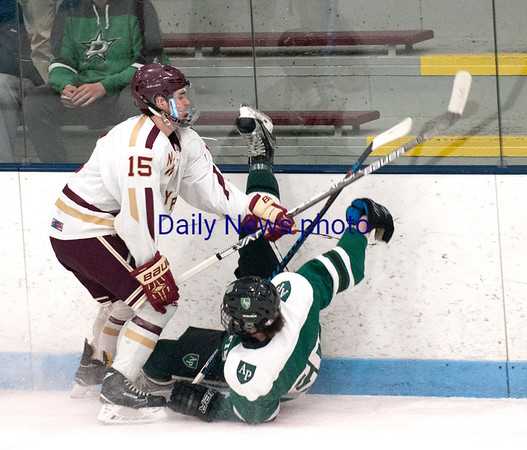 JIM VAIKNORAS/Staff photo Newburyport's Dylan Rodgers checks  Austin Prep's Connor Santos at Chelmsford Forum in Billerica Saturday.
