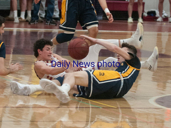 JIM VAIKNORAS/Staff photo Newburyport's Ryan Archie fights for a loose ball against St Mary's at Newburyport Thursday night.