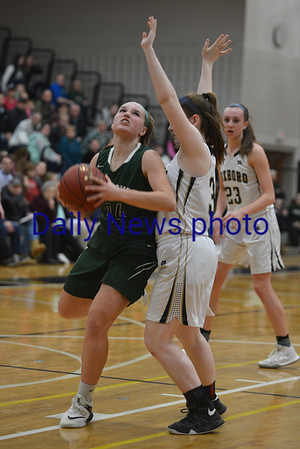 JIM VAIKNORAS/Staff photo Pentucket's Jelly Hurley makes a move  against Foxboro at Woburn high Wednesday night.