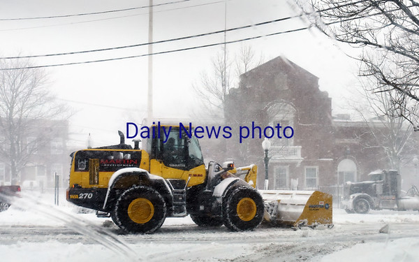BRYAN EATON/Staff photo. A snowplow clears the rotary in front of the Amesbury Police station.