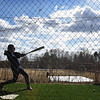 BRYAN EATON/Staff photo. Prospective Newburyport High School baseball player Jack Fehlner makes some hits in the batting cage under the sunshine as spring sports gets underway.