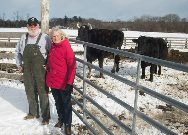 JIM VAIKNORAS/Staff photo Jack Sanborn and Donna Bartlett at their Salisbury Farm. About 200 yards behind them is the location of a proposed billboard.