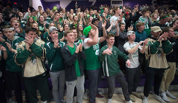 JIM VAIKNORAS/Staff photo Pentucket fans celebrate their teams victory over North Hampton in the D2 State Championship at Holy Cross in Worchester Saturday.