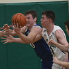 JIM VAIKNORAS/Staff photo Georgetown's Hunter Lane fights for a rebound with Lowell Catholic's Alex Laferriere at Lowell Catholic Saturday.