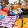 JIM VAIKNORAS/Staff photo Avah Bateman, 9, and Marley Eaton, 9, of Girl Scout troop 20044 sell cookie to voters at the Seabrook Community Center on election day Tuesday.