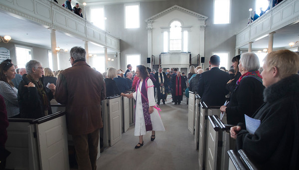 JIM VAIKNORAS/Staff photo Reverend Rebecca Michaela Bryan greets her parishioners at her installation as the 16th settled minister of the First Religious Unitarian Universalist Church in Newburyport Sunday.