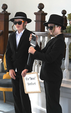 "JIM VAIKNORAS/Staff photo Gus Cordingley, 13, and his brother Leo, 11, dressed as the ""Jews""Brothers"" at a Purim Celebration at the Congregation Ahavas Achim in Newburyport Sunday morning. The celebration included games and prizes, crafts, face painting and a costume contest."