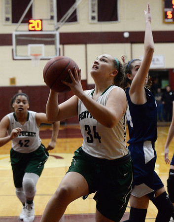 CARL RUSSO/staff photo. Pentucket's MacKenzie Currie drives to the hoop. Pentucket vs. Swampscott girls basketball in the Division 2 North semifinals. 3/5/2019