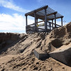 BRYAN EATON/Staff photo. The weekend's strong waves and wind caused some erosion on Plum Island Point taking away the steps that lead to the beach from the pergola at the end of the boardwalk.