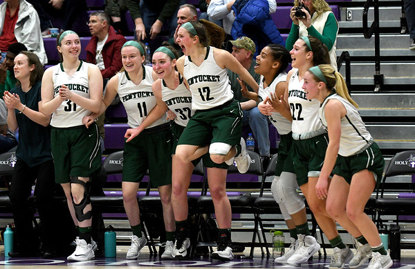 JIM VAIKNORAS/Staff photo Pentucket players explode off teh bench after defeating North Hampton at Holy Cross in Worchester Saturday to win the D2 State Championship.