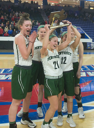 JIM VAIKNORAS/Staff photo Pentucket captains hold up their D2 North Sectional Final trophy at the Tsongas Center in Lowell.