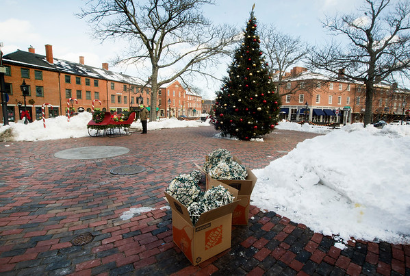 "JIM VAIKNORAS/Staff photo A boxes of Christmas lights, a tree and a sleigh, sit in Market square in Newburyport Thursday. The holiday items are props for a movie ""Ring for Christmas"" being filmed in the city."