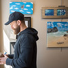 AMANDA SABGA/Staff photo<br /> <br /> Local artist and Youth Services program supervisor Lee Gordon, of Newburyport, judges artwork at the Young and Budding Artist Exhibition at the Newburyport Art Association.<br /> <br /> 3/5/19