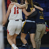 JIM VAIKNORAS/Staff photo Amesbury's Flannery O'Connor helps St.Mary's Nicolett D'Itria off the court after D'Itria injured her ankle in the D3 North final at the Tsongas Center in Lowell Saturday. St. Mary's won the game 59-48.