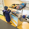 JIM VAIKNORAS/Staff photo Fourth grader Piper Marino grabs some food at the new breakfast cart at the Molin School in Newburyport.