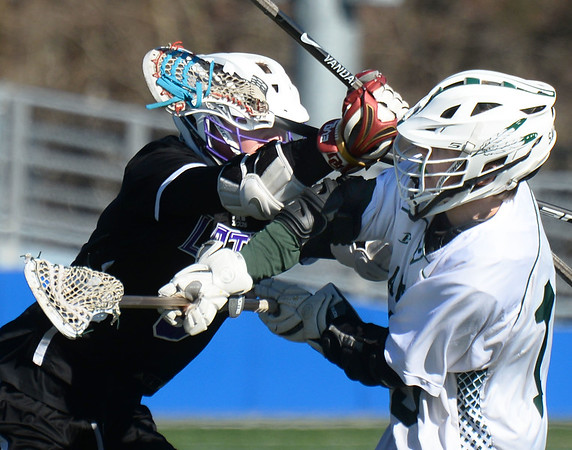 CARL RUSSO/staff photo. Pentucket senior Kevin Kershaw, right, of Groveland fights to shoot on net against Boston Latin defender.<br /> <br /> The Pentucket boys lacrosse team is off to a great start, and Kevin Kershaw has played a big part in that success. The senior, who has never been a major contributor on the team before this season, has burst out with a team-high 22 goals through the team's first five games, including three games with six or more goals. 4/17/2019