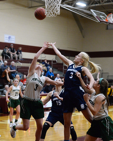 CARL RUSSO/staff photo. Swampscott's Brooke Stout fights for the rebound with Pentucket's Anna Wyner. Pentucket vs. Swampscott girls basketball in the Division 2 North semifinals. 3/5/2019