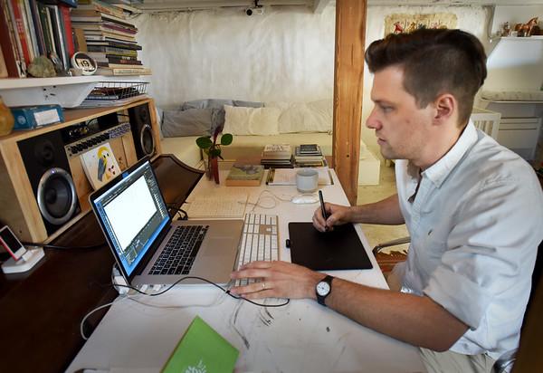 BRYAN EATON/Staff photo. Plum Island videographer Peter Brant in his basement work space.