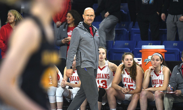 JIM VAIKNORAS/Staff photo Amesbury coach Greg Dollas walks the sidelines against St.Mary's in the D3 North final at the Tsongas Center in Lowell Saturday. St. Mary's won the game 59-48.